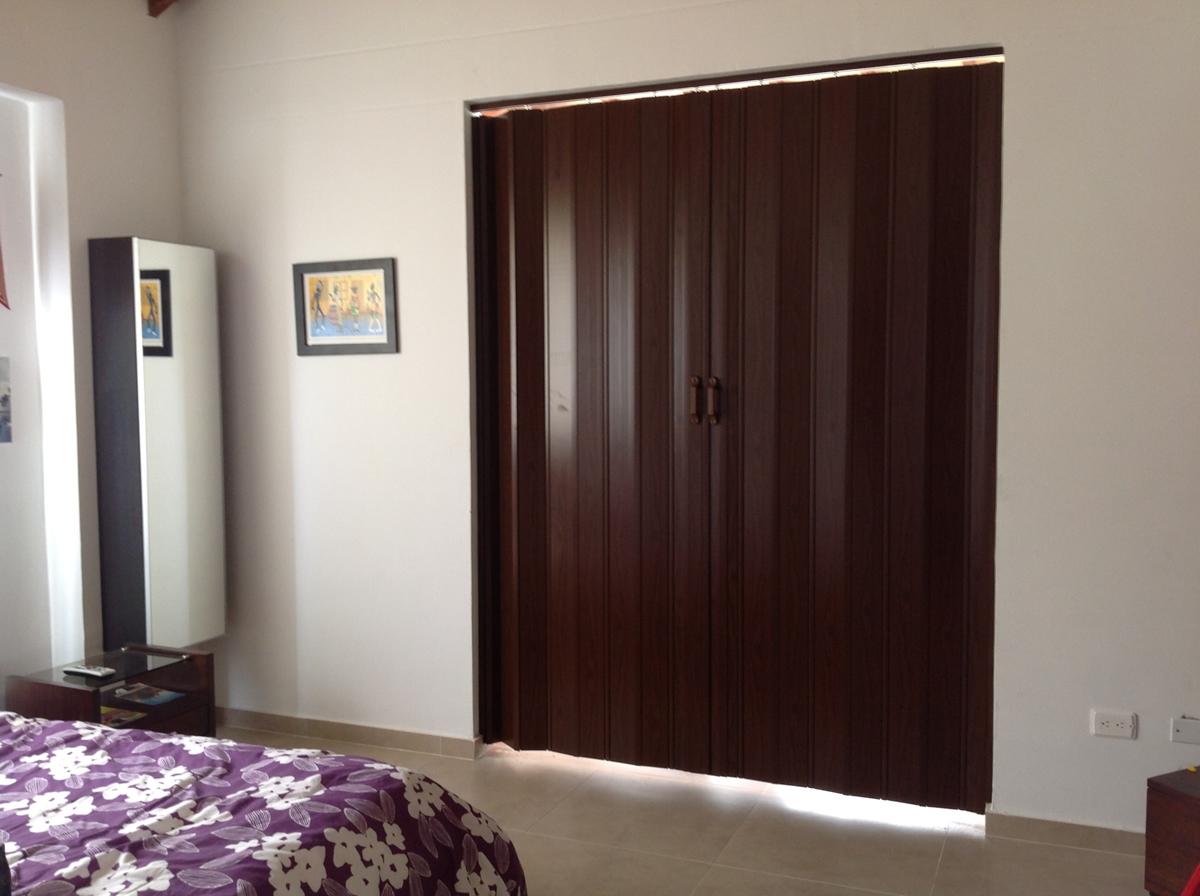 Cortiambientes persianas toldos y cortinas for Cortinas para puertas de armarios